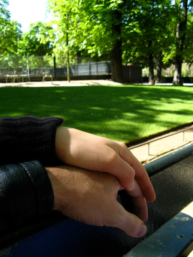 Josiah and Gina's hands on park bench in Paris