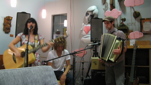 The Music Room playing at Bloom Coffee + Tea (Shane Grammer art in background)