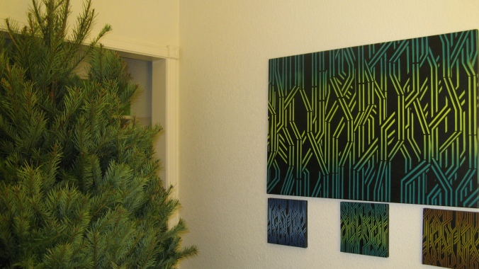 undecorated christmas tree near art canvas