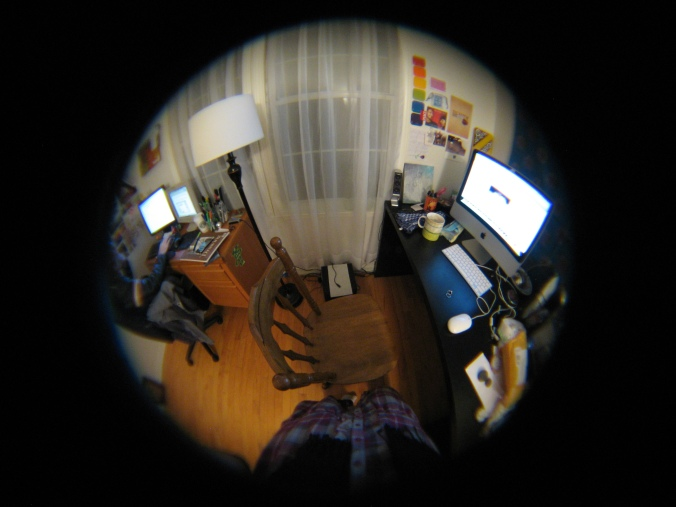 fish eye image of home office creative workspace
