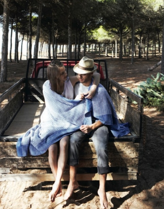 girl and man on back of truck with blanket in forest, from spring Toast UK catalogue