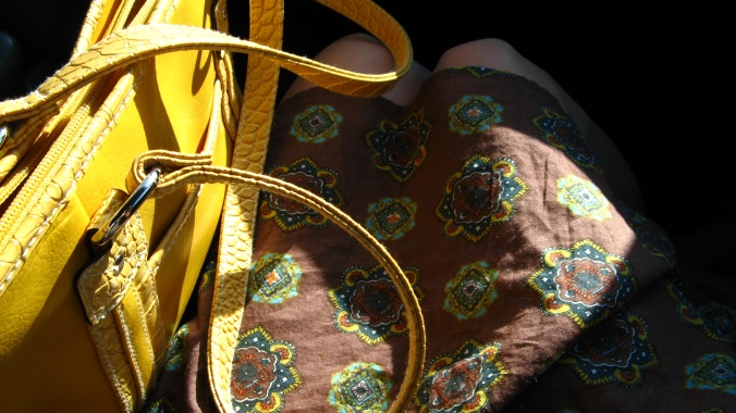 sunday drive image of mustard yellow leather purse with brown, green and mustard yellow print summer dress