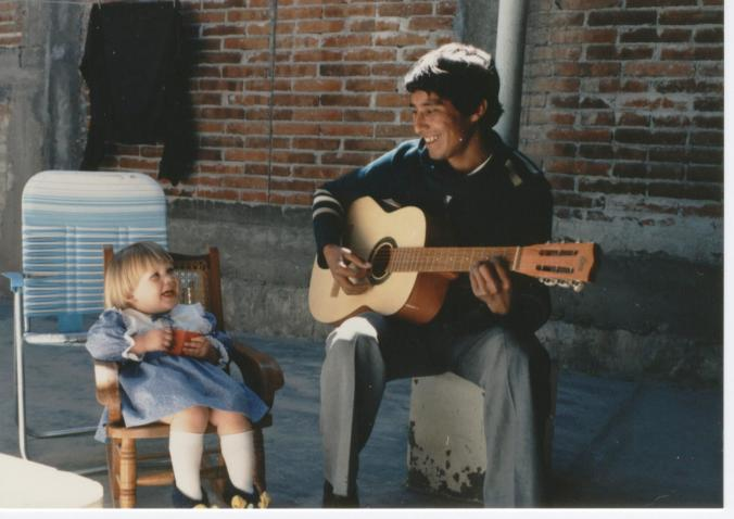 Oaxaca, Mexico, gringo toddler with spanish man playing guitar