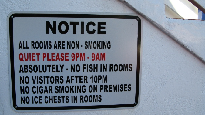 the August Break image of a notice on hotel courtyard near a fishing pier in san diego