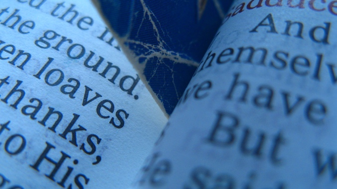 the final August Break photo, an image of a worn bookmark in the pages of the Bible