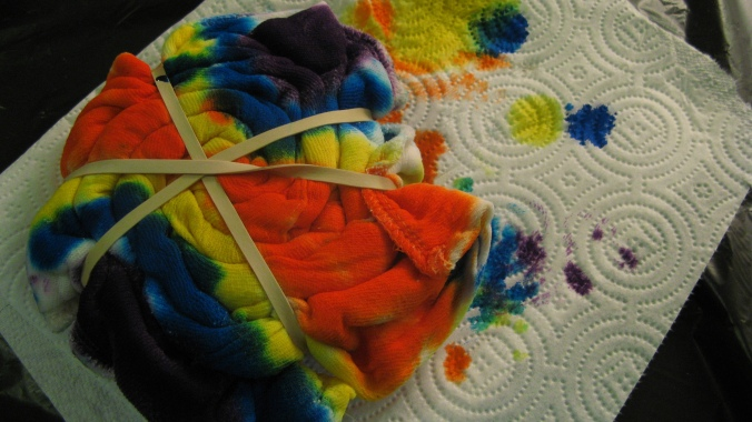 the August Break image of a diaper in the process of being tie-dyed
