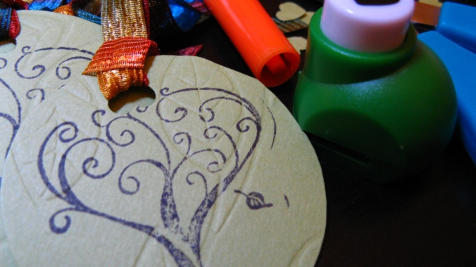 close-up of tree stamp and heart whole punch