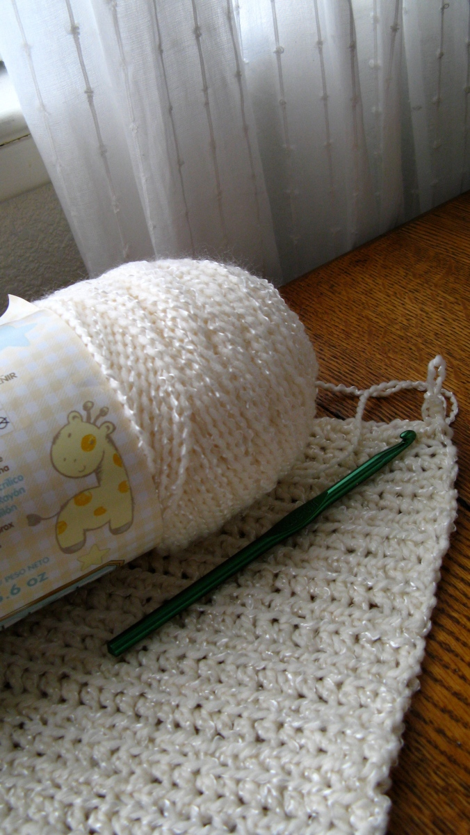 the beginnings of an baby sweater inspired by classic irish fishermen's sweaters