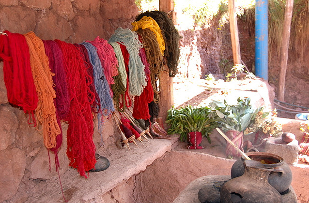 The yarn that is hanging is dyed naturally from flowers and plants, such as eucalyptus.