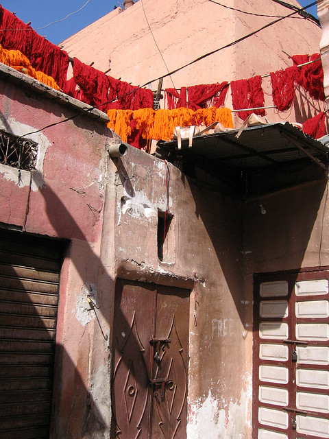 dyed yarn drying in the sun in morocco via chimblysweep on flickr