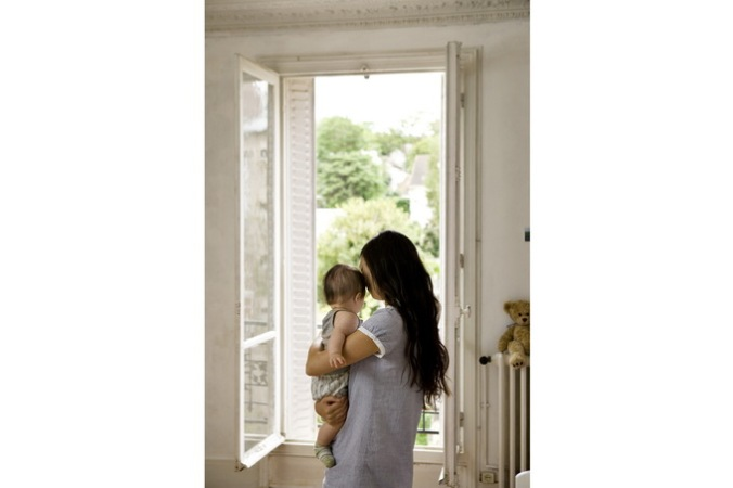 woman and child in front of open door in white interior - photography from danish photographer morten holtum http://www.holtum.dk/