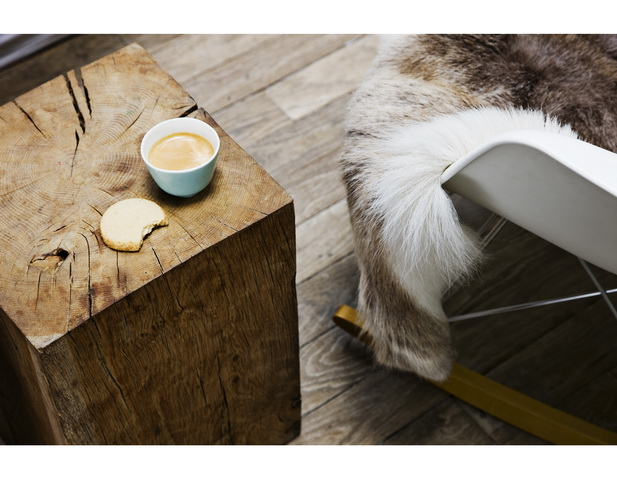 photography from danish photographer morten holtum http://www.holtum.dk/  - sheepskin, wood side table, wood floor, coffee and biscuit