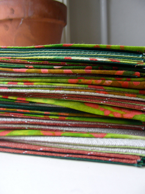 Handmade fabric banner with green cotton, natural and rust orange-brown linen and green and coral coloured dutch style batik via deep indigo on flickr