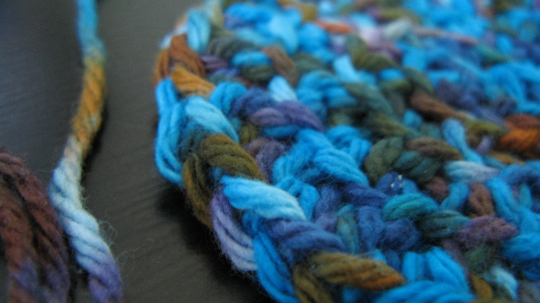 close-up image of hand-dyed cotton yarn - fall colors - blue, orange, brown, green