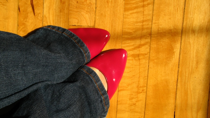 fuschia red pink magenta patent shoes with jeans on a hardwood floor - photograph by oaxacaborn gina munsey