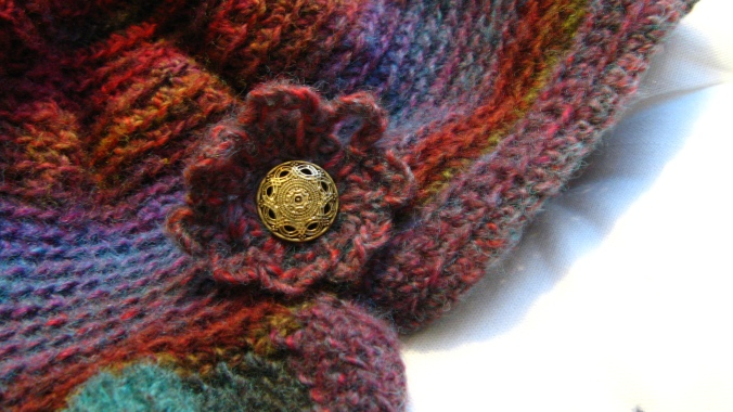 thrifted button on handmade crochet hat - freeform orignal pattern from lion brand yarn amazing ruby