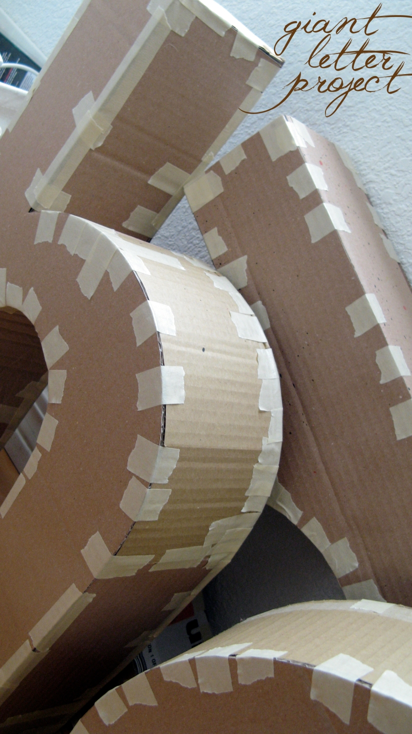 giant cardboard letters in progress - to be used as home decor