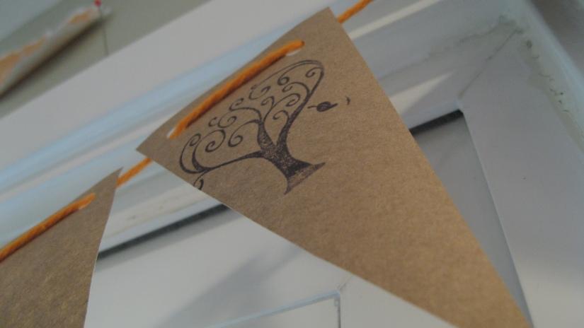 kraft paper pendant/bunting/garland on orange string with tree stamp