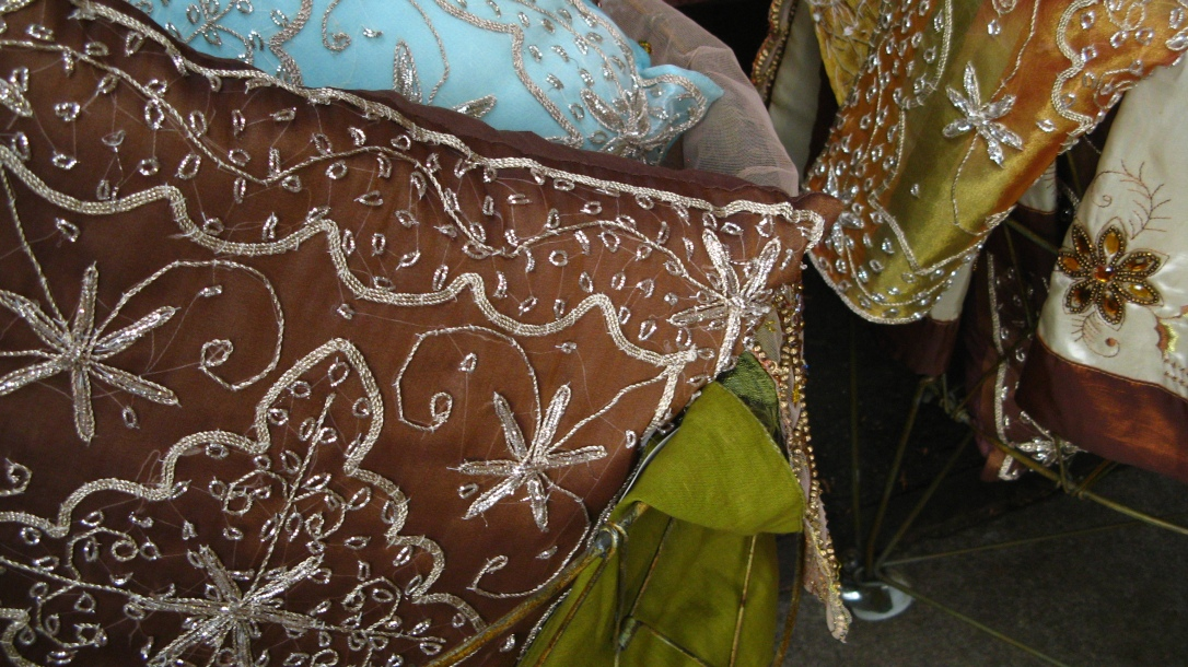 green and brown and blue embroidered and sequined silk pillows / throw cushions - photo taken at apple hill in camino, california