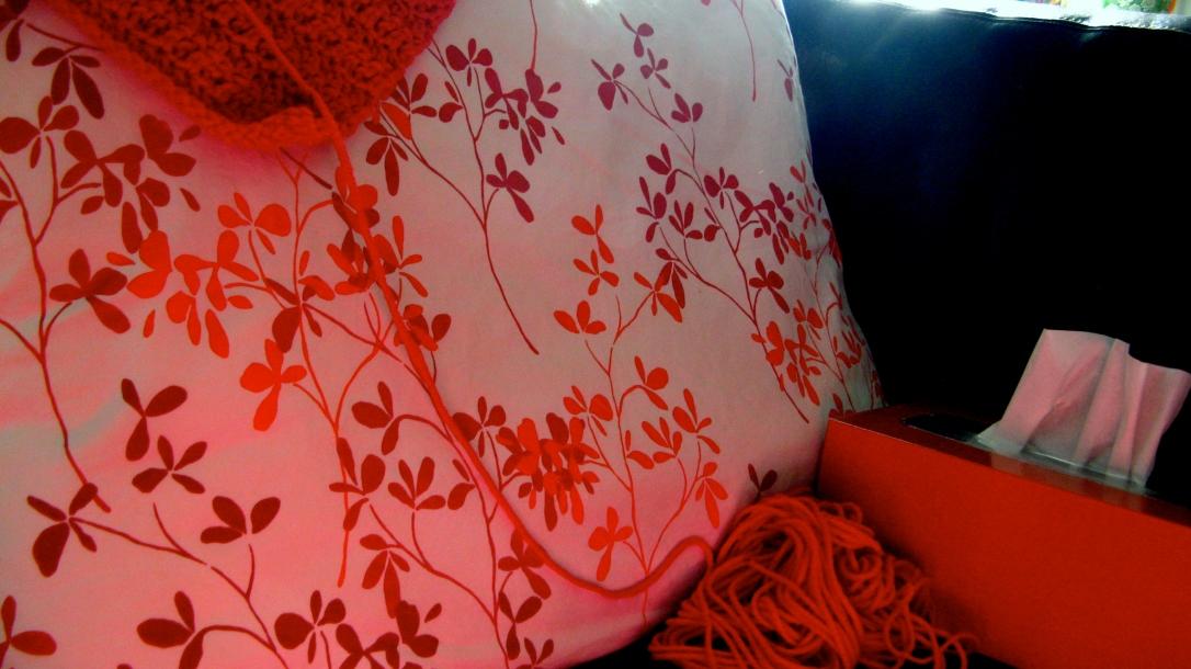 red yarn - red, orange and white pillow case - orange kleenex box