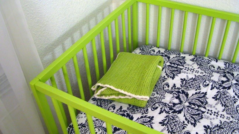 IKEA SOMNAT crib in lime green with Sophia Fitted Crib Sheetby JoJo - Damask Print in black and white and handmade crochet cotton baby blanket in lime green
