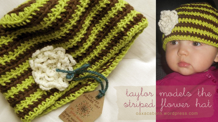 baby taylor models a handmade striped green and brown crocheted hat with an off-white flower