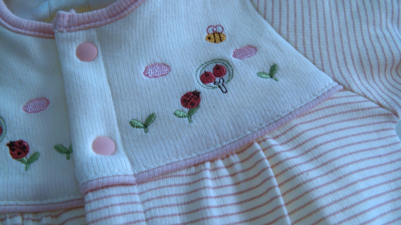 close-up macro photo of detail on japanese baby girl outfit