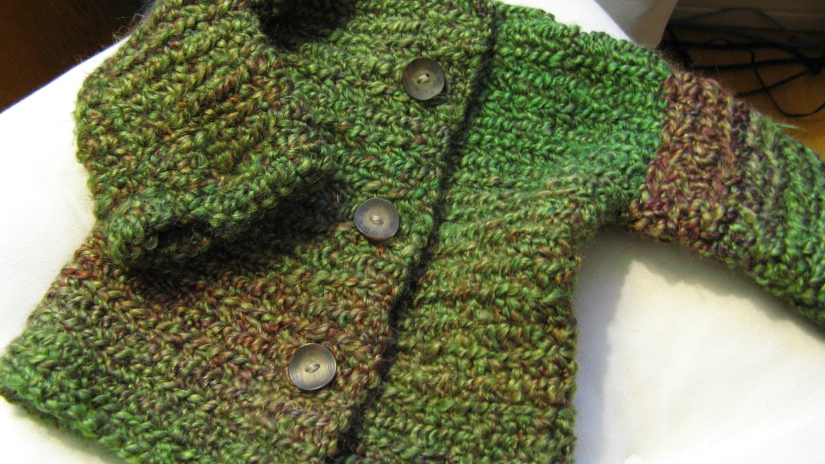 handmade crochet simple baby sweater - variegated green with brown buttons