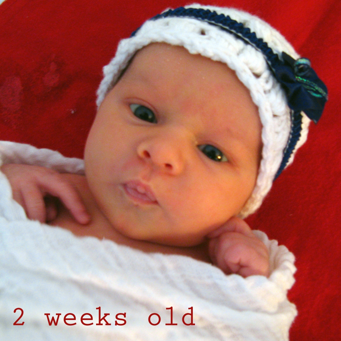 Aveline Alenka - 2 weeks old - handmade crochet hat - cotton gauze baby swaddling cloth by Living Textiles