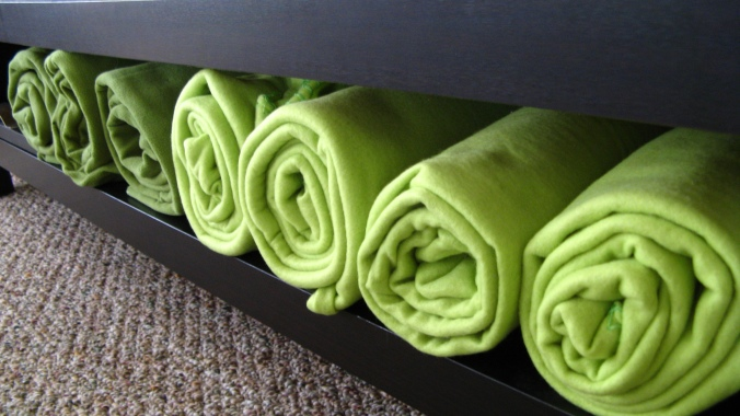 rolled green fleece blankets