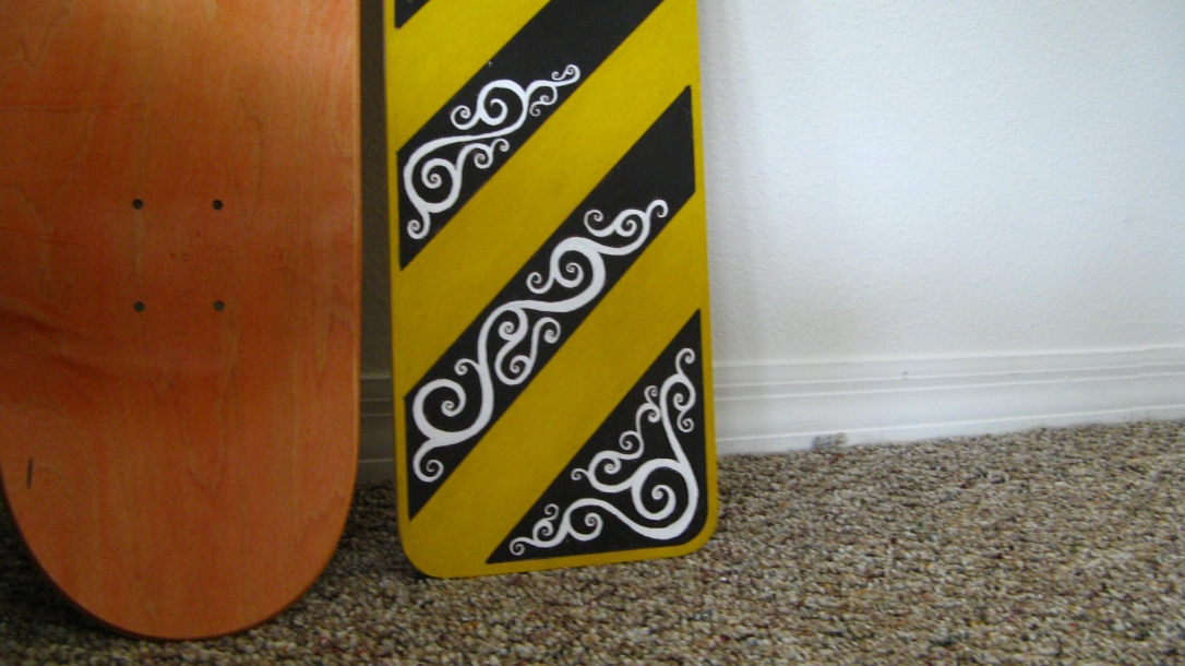 maple skateboard deck and 26PM Josiah Munsey yellow, black and white art piece on wood