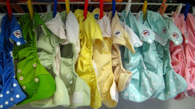 hanging pocket cloth diaper covers in assorted colors