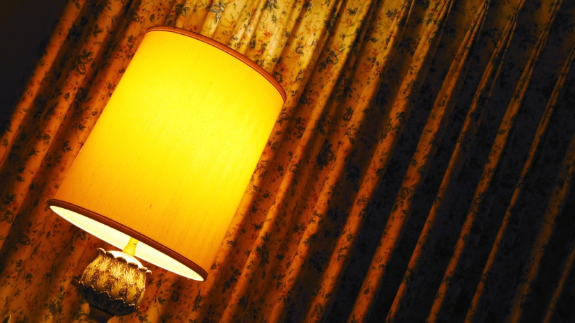 Lit lamp against floral drapes - Earth Hour 2011