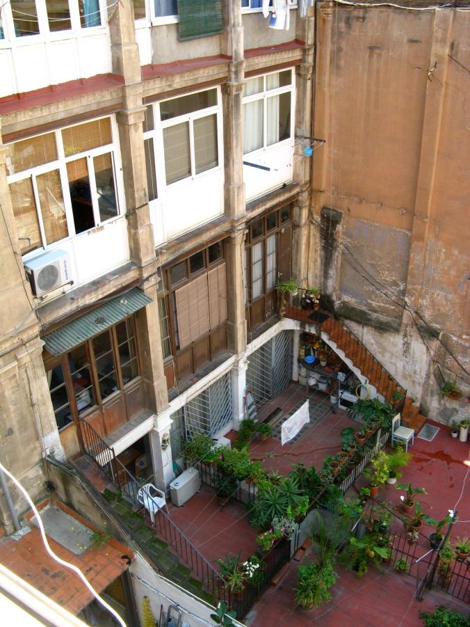 courtyard of apartment building near las ramblas in barcelona, spain