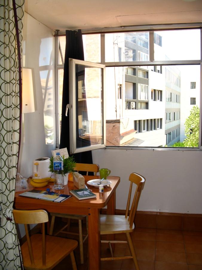 open apartment window in la rambla, barcelona, spain