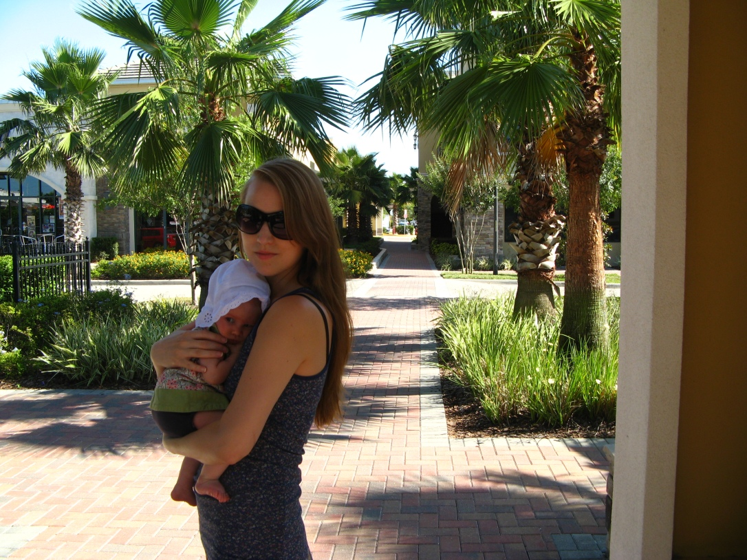 holding aveline near florida palm trees (baby's sundress and sunhat both from the children's place; mama's tank from target)