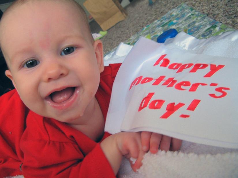 baby Aveline Alenka holding sign reading Happy Mother's Day