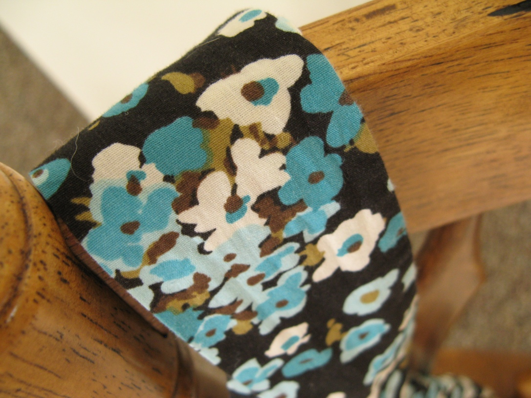 turquoise, white and navy floral fabric belt over chair back