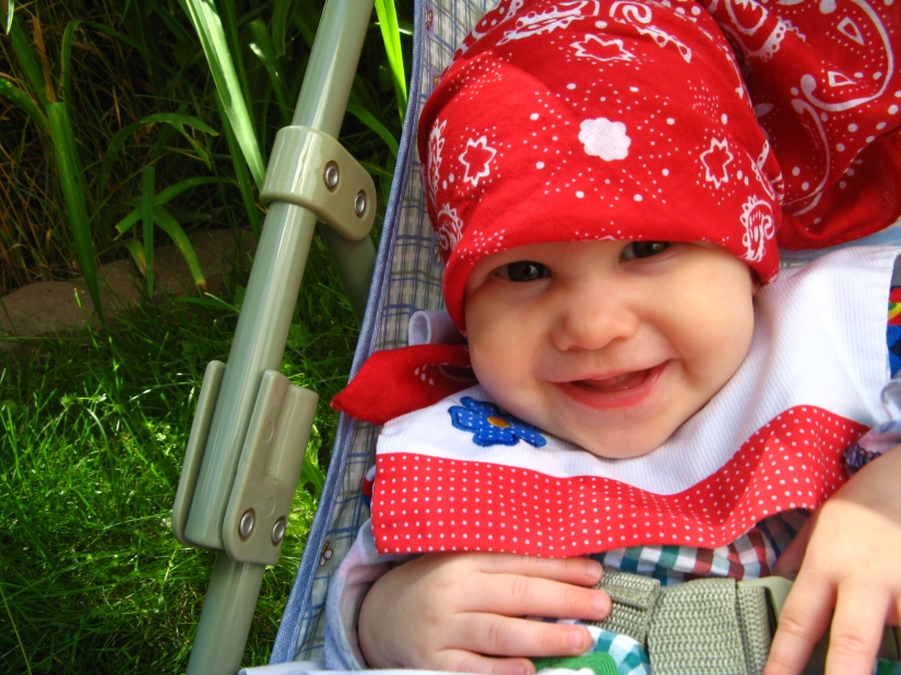 Aveline wearing red bandana, smiling