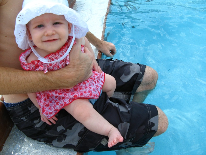 Baby Aveline's first swim in the pool