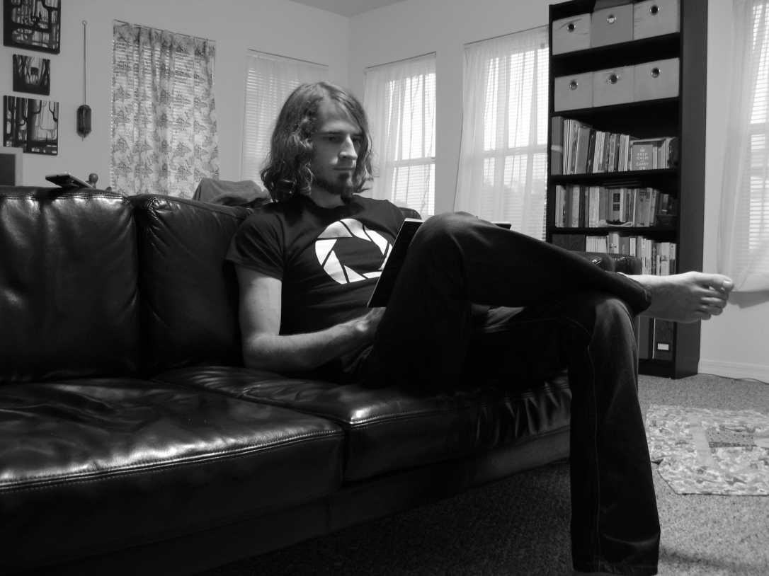 Josiah reading a book in the living room - black and white photo - 30 Day June Photography Challenge - someone you love