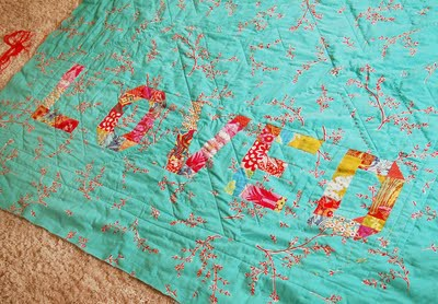 Loved Patchwork Typographic Quilt via DisDressed - Textiles Board on Oaxacaborn