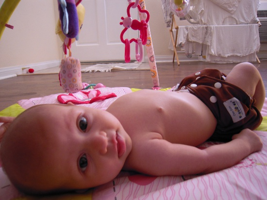 5 - Guest Post - Cedar Taylor - The Vintage Wife - Baby Lucy on Playmat wearing FuzziBunz Cloth Diapers
