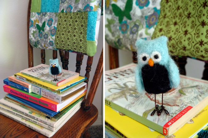 Felted Owl on stack of children's books on wooden chair with handmade quilt on back of chair-Oaxacaborn-Aveline's room