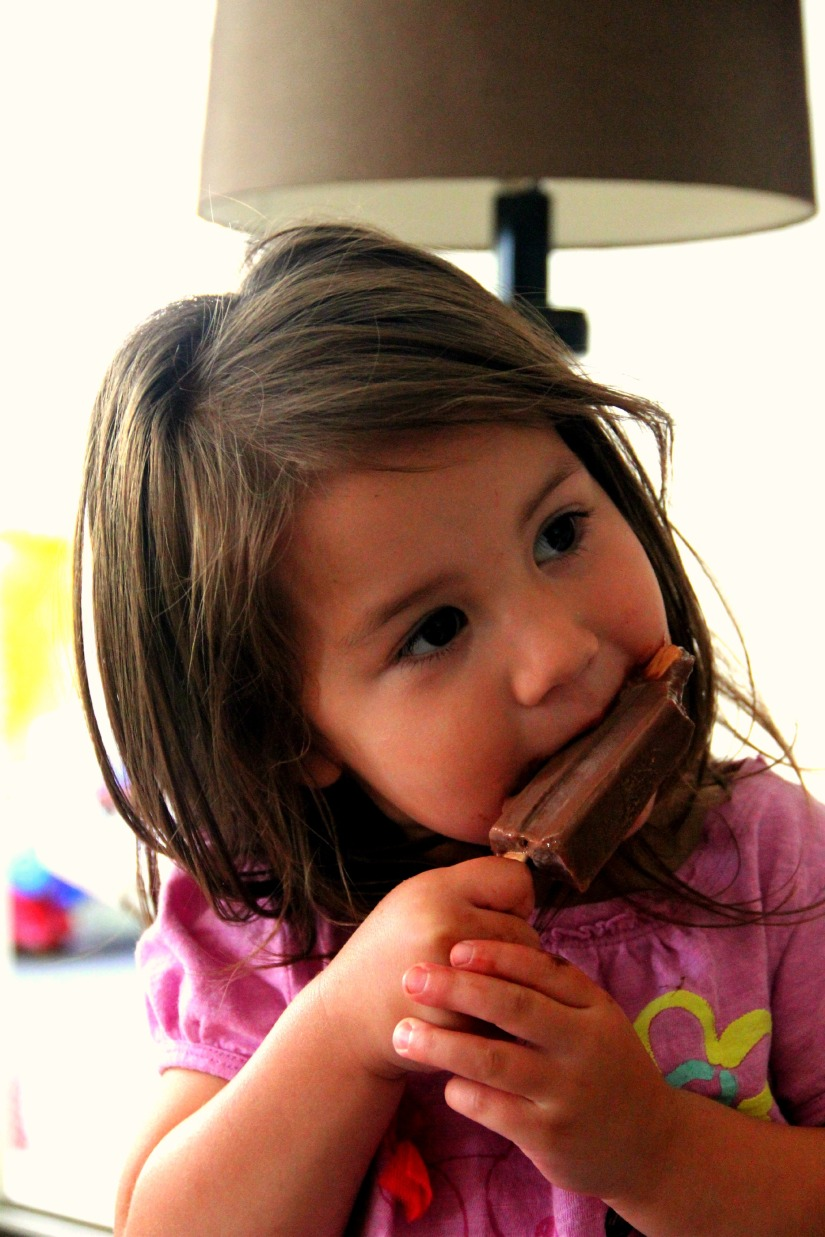 Amelia of More Fun with an Apron eating a homemade fudgepop with popsicle recipe