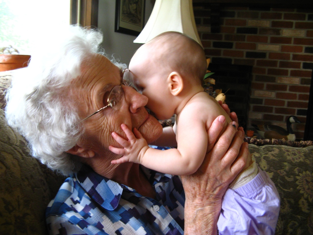Baby Aveline giving Great Great Grandma a kiss on the cheek