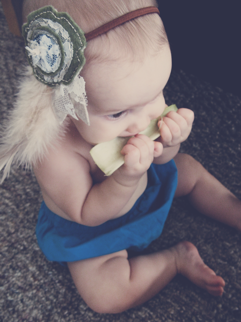 Baby eating organic celery - Baby wearing boho chic lace felt and feather headband via Oaxacaborn on Etsy