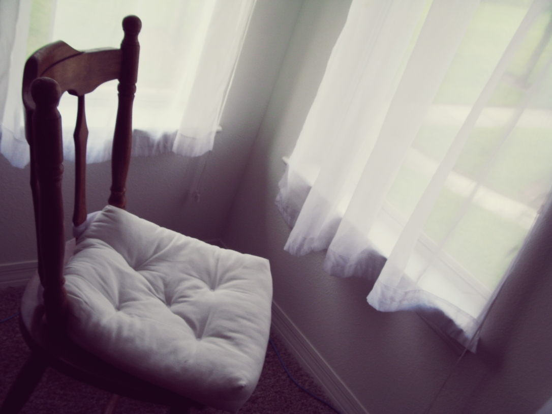 Friendship - August Photo Challenge - the August Break - Day 3 - empty wooden chair with white cushion in corner near window with white curtains