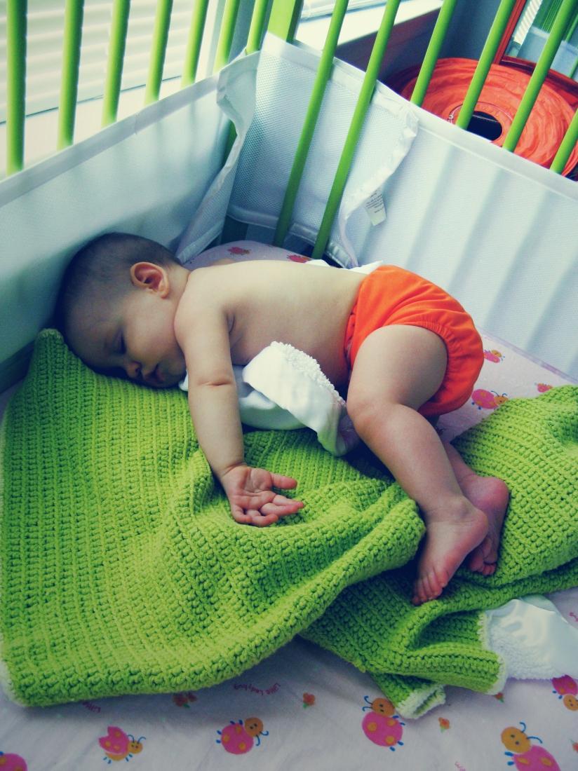 Aveline in orange FuzziBunz diaper, sleeping in green IKEA Somnat crib - Staying Cool - August Photo Challenge - Day 2 - The August Break