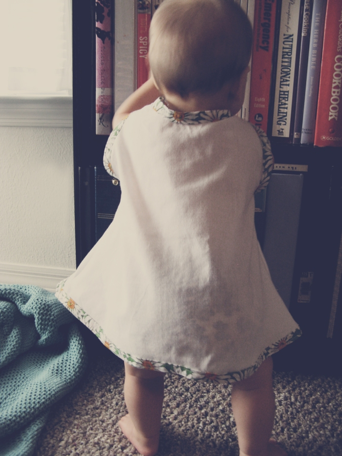 Aveline in handmade vintage-inspired mod dress in white cotton with daisy trim